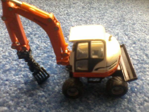 Spielzeugauto - Baustellenfahrzeug - Greifbagger - Bagger - Schaeff -