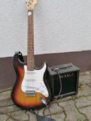 e Gitarre mit kleinen Verstärker