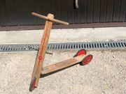 Kinderroller Trettroller aus Holz Holzroller
