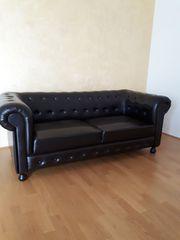 Schwarze Kunstleder Couch