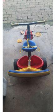 Dreirad mit Stange und Haltegurt