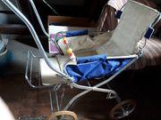 Kinderwagen Kinderkarre von 1968 voll