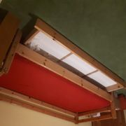 Holzbett mit Bettkasten und Eckschrank
