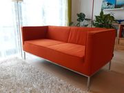 Sofa in orange terra Zweisitzer
