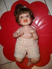 Puppe aus Porzelan