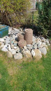 Roter Granitsteinbrunnen für den Garten