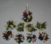 Kerzenkränze aus Textilblüten
