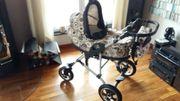 Schöner Kinderwagen mit 3 Aufsätzen -