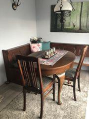 Alter Esstisch aus Holz antik