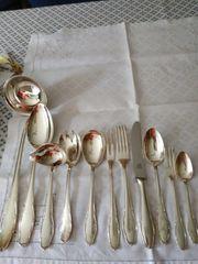 12 teiliges Silberbesteck mit Zubehör