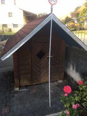 Spielhaus-aus-Holz-Holzhaus-für-draußen-Garten-Kinderspielhaus