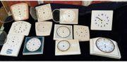13 Keramik-Uhrenschilder teilweise mit gewölbter