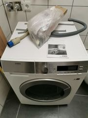 XXL-Waschtrockner AEG L87695WD 914 605