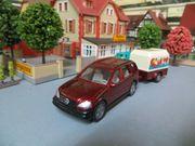 Modellauto Siku MB mit Anhänger