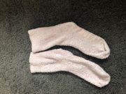 Flauschige getragene Socken