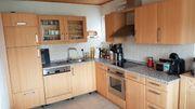 Eckküche in Holzoptik