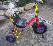 Dreirad Marke Puky rot-gelb für