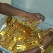 AU Goldbarren Goldnuggets Goldstaub und