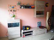 Schöne pflegeleichte Wohnwand mit Sandeichenoptik