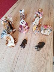 Kripenfiguren und Schafe
