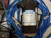 Zwei gebrauchte ReptileRain-Beregnungsanlagen mit Hochdruckpumpen