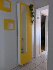 Stylischer Drehschrank Schuhschrank drehbar gelb