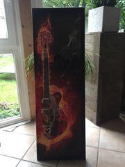 Leinwandbild Brennende Gitarre