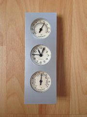 Thermometer Quarz-Uhr und Hygrometer in