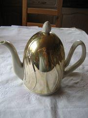 Thermohaube mit alter Kaffeekanne aus