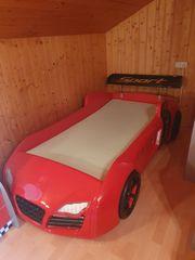 Bett mit Matratze Schrank und