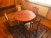 Runder Tisch dunkles Holz