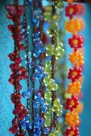 Blütenreige Glasperlen Kette