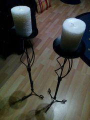 2 schmiedeeiserne Kerzenständer