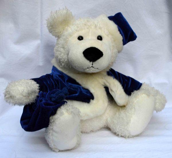 Stofftier weißer Bär mit blauer