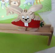 Holzspielzeug laufender Hase