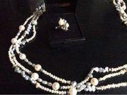 Schmuckset aus Perlen und Diamanten