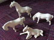 4 Pferde verschiedene Größen und