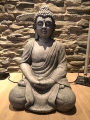 Dekorativer Sitzbuddha