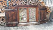 Holzfenster mit Läden
