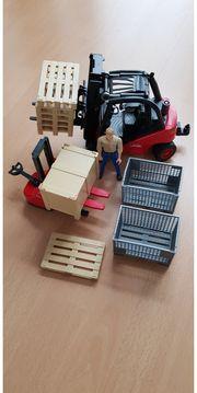 Spielzeug Gabelstabler Hubwagen v Bruder