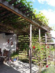 Massive Pergola Terrassenüberdachung aus Holz