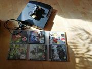 Playstation 3 mit 6 Spielen