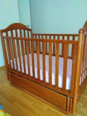 Kinderbett mit Wippfunktion im guten