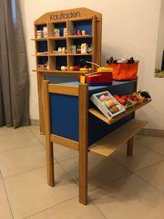 Kinderspiel-Kombination Kaufladen und Kasperle-Theater