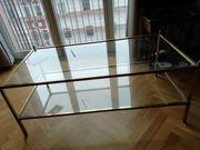 Tisch aus glas und Metall