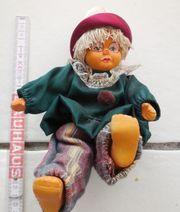 Porzellanpuppe Clown sitzend