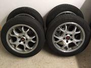 4 Reifen auf Alu-Felgen 205