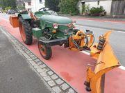Traktor oldtimer Meili mit schneeflug