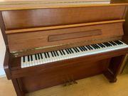 Klavier in Kirschholz