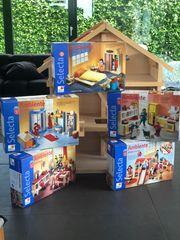 Puppenhaus aus Holz von Goki